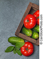 Cucumbers and Tomatoes in wooden box