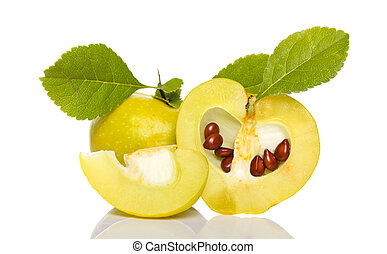arrangement of small quince with seeds and grean leaves isolated on white