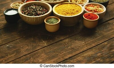 Arrangement of spices in small bowls - Collection of various...