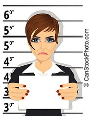 Arrested businesswoman posing for mugshot holding a...