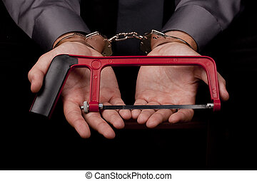 Arrested in handcuffs holding a hacksaw with a goal to...