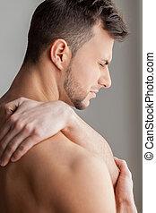 arrière, épaule, musculaire, negativity, isolé, vue, gris, workout., jeune, douleur, debout, sien, exprimer, quoique, sentiment, toucher, fond, homme, après