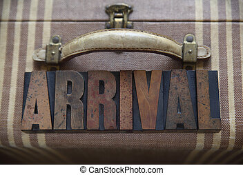 arrival word on old luggage