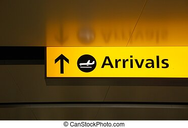 yellow arrivals sign at a international airport