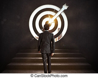 Arrive at a goal of success. Businessman climbing the stairs up to a target.. 3D Rendering