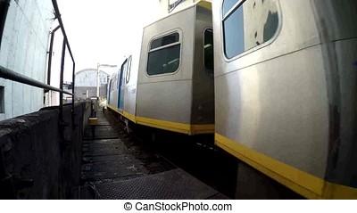 Arriving Light Rail Transit Train in passenger station, a...