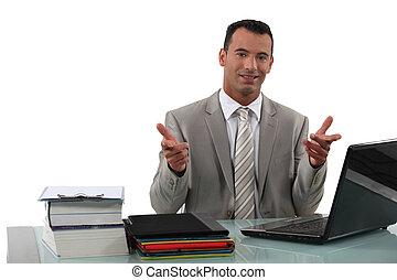 Arrogant businessman sat at desk