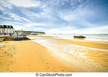 Arromanches les Bains, seafront beach and remains of the artificial harbour, used on D-Day in World War II. Normandy, France.