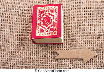 Arrow and Islamic Holy Book Quran
