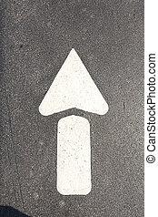 arrow at the black street