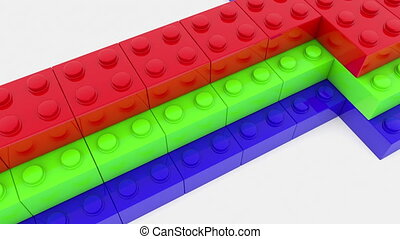 Arrow built from colorful toy bricks