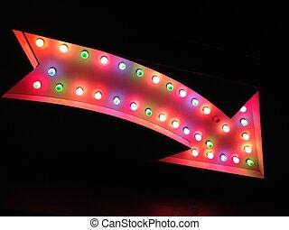 arrow fairground carnival circus vegas style arrow pointing at night