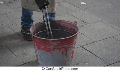 Arrow hardening in bucket with cold water - Metal arrow ...