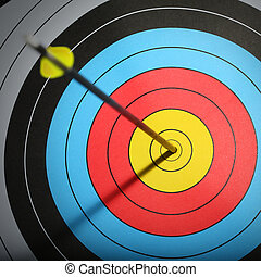Arrow hit goal ring in archery target.