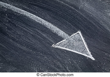 arrow in white chalk on blackboard