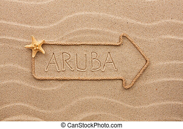 Arrow made of rope and sea shells with the word Aruba on the...