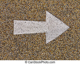 Arrow on stony surface