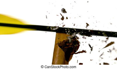 Arrow shooting through a cigarette in slow motion