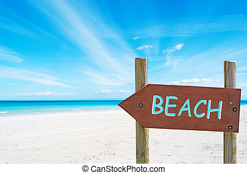 arrow sign at the beach