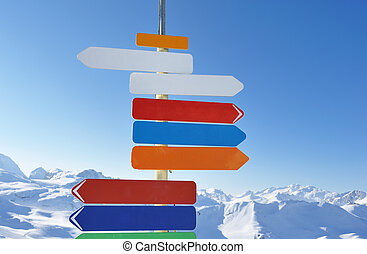 Arrow sign in mountains - Arrow sign at mountains with snow ...