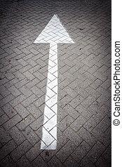 Arrow sign on a road