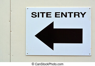 Arrow sign to site entry