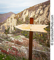 Arrow sign to the left in nature for torurist to eagle gorge natural monument viewpoint.