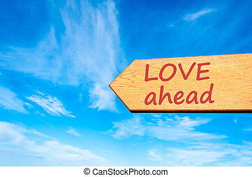 Arrow sign with Love ahead message