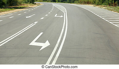 Arrow signs as road markings on suburban driveway
