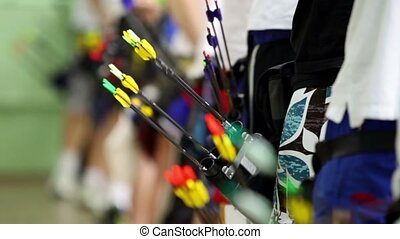 Arrows in quivers on several archers