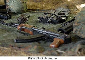 Arsenal of guns lying on the ground