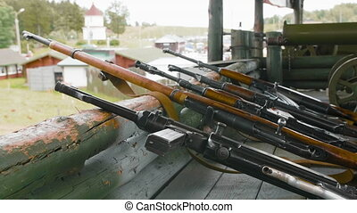 Arsenal of weapons, close-up of machine guns, firearms,...