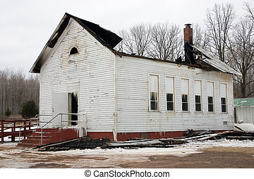 Arson - a building that the roof has been burned off of