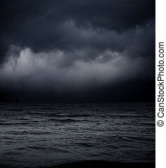 art abstract dark background. sea waves against the black sky