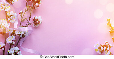 Art Beautiful cherry tree tender flowers on pink background. Amazing spring blossom