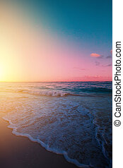 Art Beautiful sunrise over the tropical beach;  paradise summer vacation