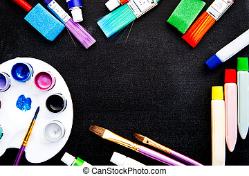 Art - Blank Chalkboard surrounded by art and craft equipment
