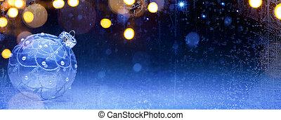 art Blue Christmas; Holidays background with Xmas decoration on snow