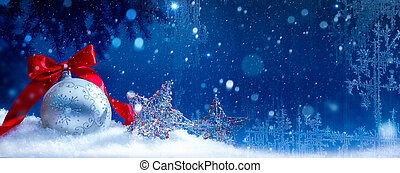 Blue Christmas; Holidays background with Xmas decoration on snow