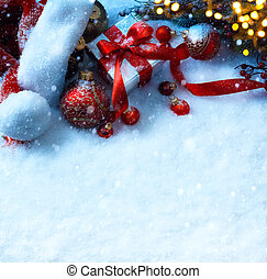 art Christmas background with a red ornament, fir tree and gift box in snow