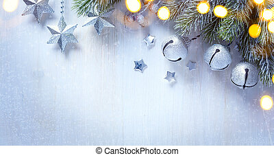 art Christmas background with a silver ornament, christmas stars, berries and fir in snow