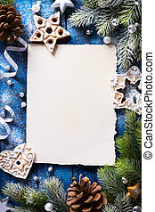 art Christmas background with fir branches and Gingerbread cookies