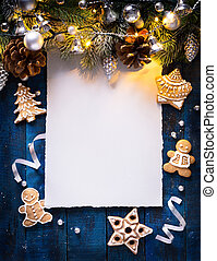 art Christmas background with fir branches and silver balls with holidays light