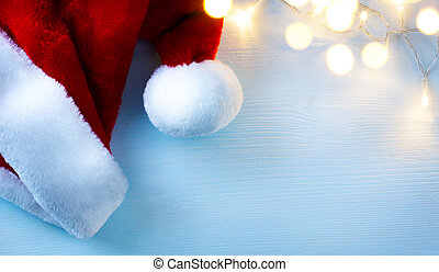art Christmas background with Santa Claus hats  and Christmas tree light