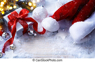 art Christmas festive background with Christmas balls and gift box on snow