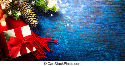 Art Christmas Gift and Tree Decoration On Blue Wooden Background
