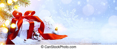 art Christmas holidays background; gift box and Christmas tree decoration