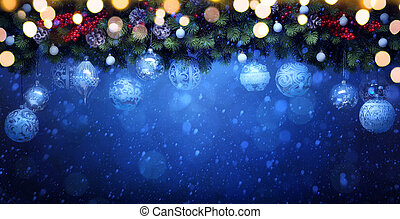 art Christmas holidays decoration; Fir Branches and white bauble on blue snowy background