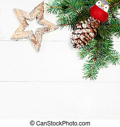 Art Christmas tree decoration on white wooden background with copy space for text. Christmas frame, border