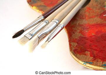 Artists' brushes and a palette.